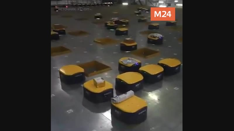 Роботы сортируют посылки в Китае
