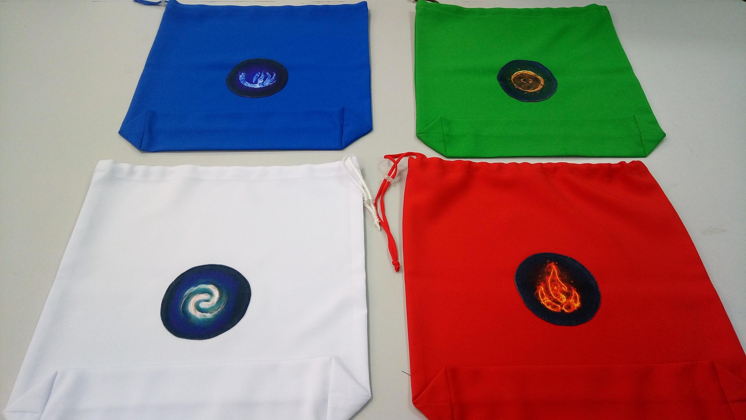 Сшили магические мешочки с символами земли, воды, огня и воздуха.