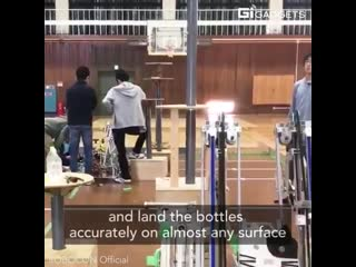 These robots nailed the bottle-flip challenge. japanese high school students built them for the 2018 robocon robotic competition