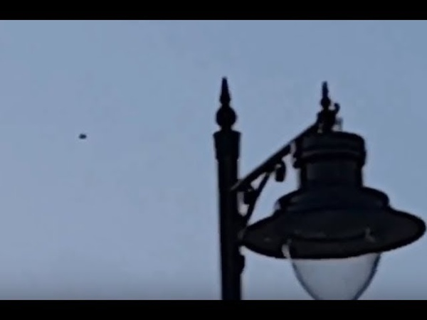 BLACK DISC SHAPED OBJECTS FILMED OVER LONDON - MULTIPLE WITNESSES