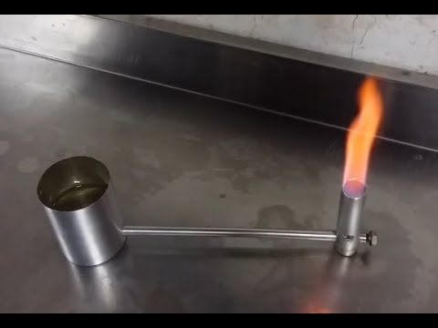 Alcohol burner with remote feeding