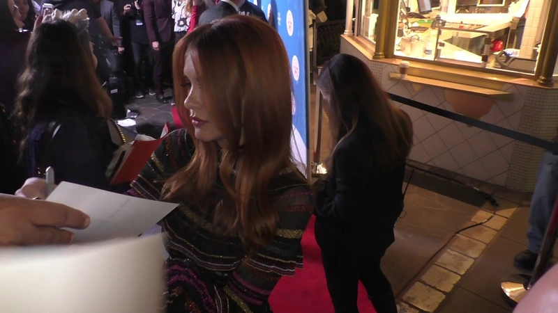 Danneel Ackles signs for fans at The Opening Night Of Life Sized Gingerbread House Experience at The