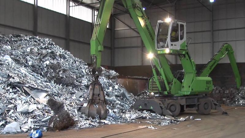 SENNEBOGEN - Scrap Handling 821 Electro and 825 Material Handlers with magnet and orange peel grab