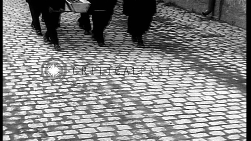 Bodies await burial as civilians walk past coffins in Neunburg, Germany. HD Stock Footage
