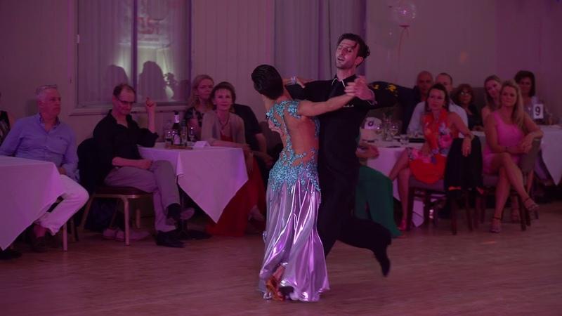 Gigo Kuguashvili and Viktoriya Wilton performing American Smooth Waltz