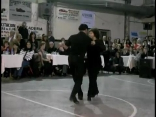 Miguel-angel and osvaldo zotto dancing with their mother