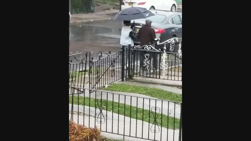 A mom was wondering where her son had gone - she found out that he had seen an elderly neighbor walking in the rainstorm without