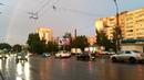 город после дождя. радуга.