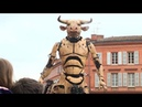 A minotaur and giant spider parade through Toulouse streets