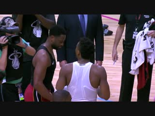 Donovan Mitchell and D-Wade exchanging jerseys