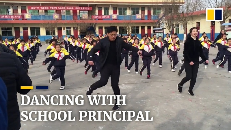 Chinese school principal teaches pupils shuffle dance during the break