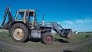 Трактор Беларусь копает траншею под фундамент timelapse