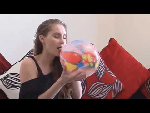 Cute Girl Blowing Balloons To Pop