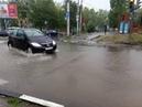 Бурные реки из за ливня на улице Новоузенской