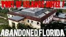 ABANDONED FLORIDA PORT OF ISLANDS HOTEL AT NIGHT