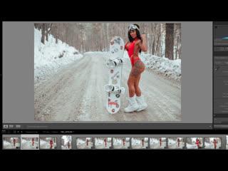 Горячая фотосессия девушки в боди и сноубордом
