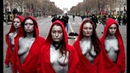 Topless 'Mariannes' confront police during 'Yellow Vest' protest