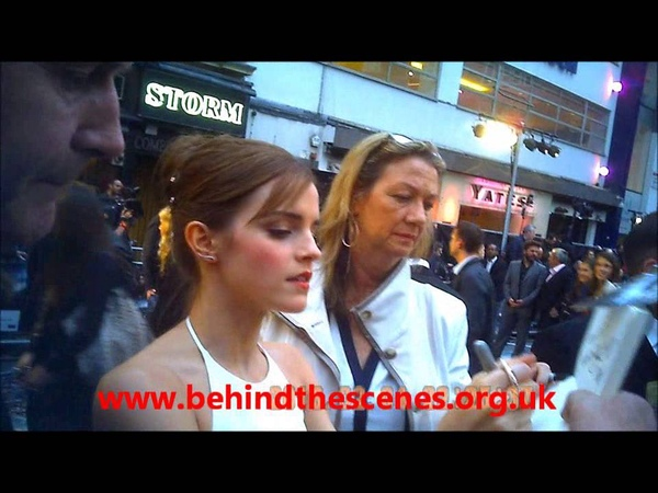 Emma Watson signs autographs at the Noah Premiere in London on the 31st March 2014.
