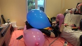 Neo Luka in black latex popping a poor balloon