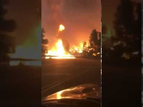 Brave young lady ran into a wall of fire on Kanan Dume Road, CA, USA 11/10/18