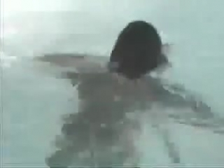 Two girls fight in the pool