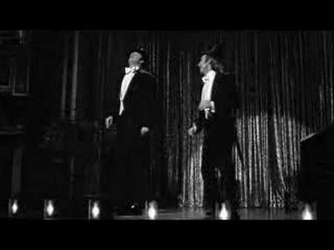Young Frankenstein and his creature dancing