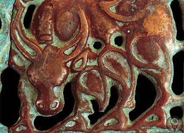 Об изображениях драконов на древних артефактах, найденных на территории Сибири.
