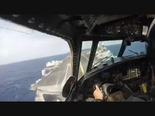 Cockpit view of E-2 Hawkeye during landing on aircraft carrier