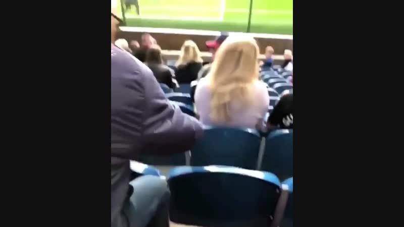 A woman and the stream of soccer balls to her face