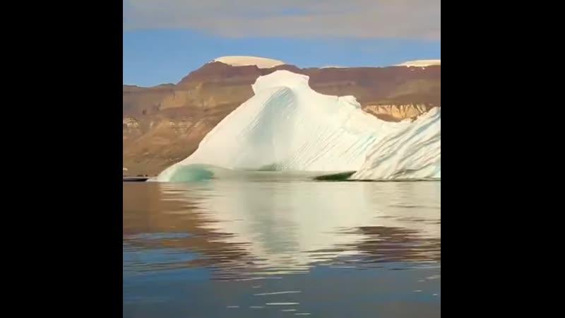 An iceberg flipping over