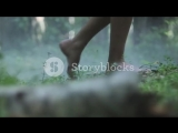 close-up-of-girl-bare-feet-walking-on-a-green-grass-in-the-forest_hczyjgtn__PM