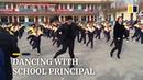Chinese school principal teaches students shuffle dance during break