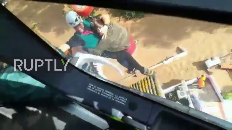 Spain Stranded woman airlifted to safety from balcony in flood-hit Malaga