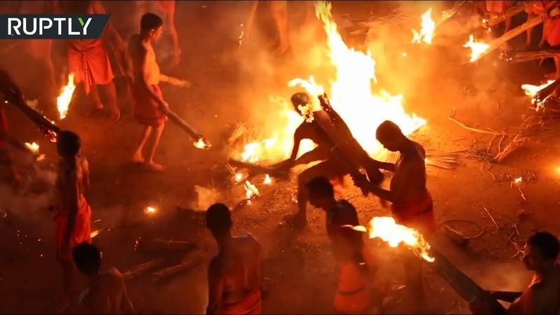 Fire Fight Devotees of Hindu goddess Durga celebrate Agni Keli festival in India