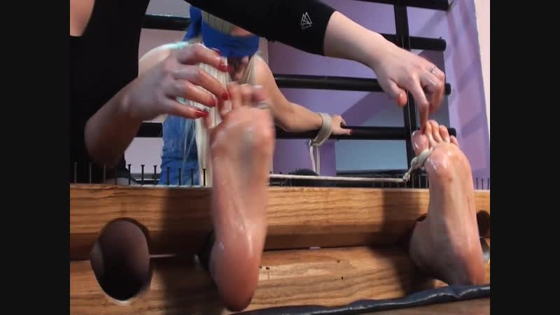 TickleNail - Huanita blindfolded and toe tied in stocks