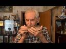 Герой Советского Союза Н. Е. Оловянников играет на трофейной губной гармошке