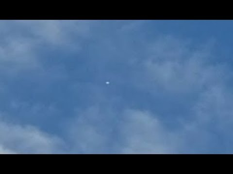 One Of Two UFOs Captured Flashing Frantically As Plane Flies Close To It. Liberty, Missouri
