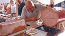 Slovenia Street Food. Cutting Huge Mortadella and Ham