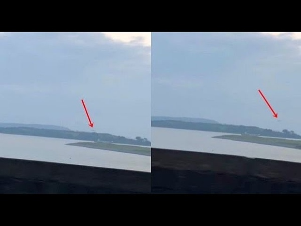 Cigar-Shaped UFO hanging in the sky over Spike Island, Cork, Ireland before it speeds away