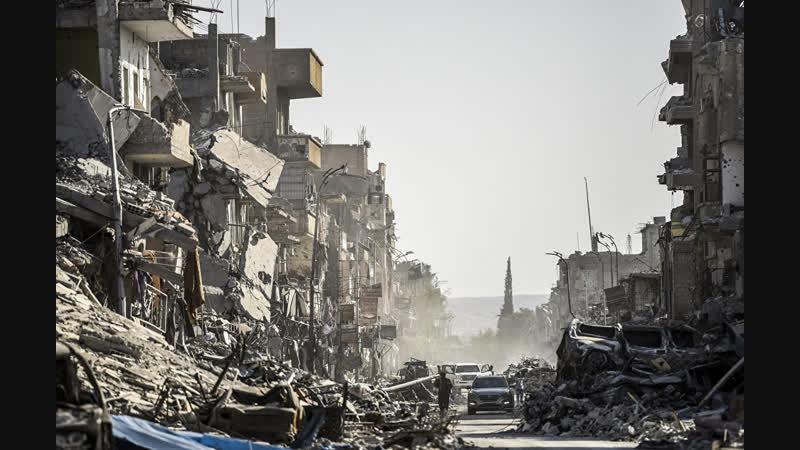 Массовые захоронения в Ракке.