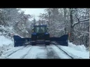 Snow plowing in Alps Northern Italy