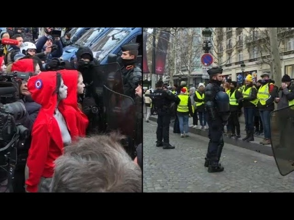 Sur les Champs-Élysées, gilets jaunes et Femen face aux CRS
