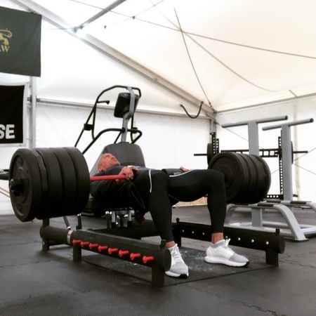 @therock on Instagram Personal best 460lbs hip glute thrusts to warm up before hitting legs Solid gains in strength and coach @daverienzi and I