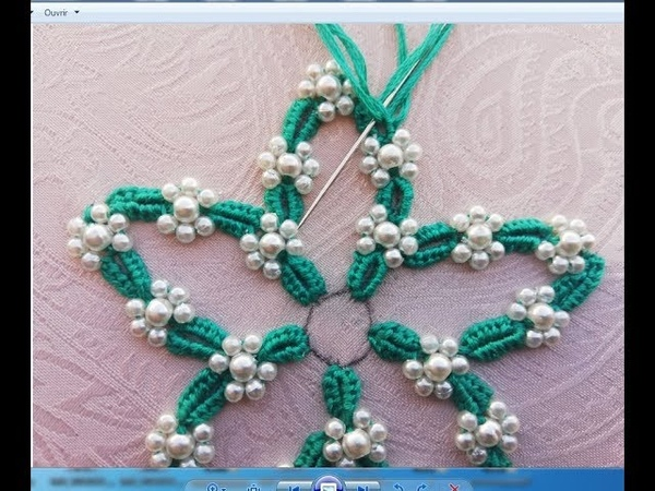 Hand embroideryhand embroidery design with pearls.