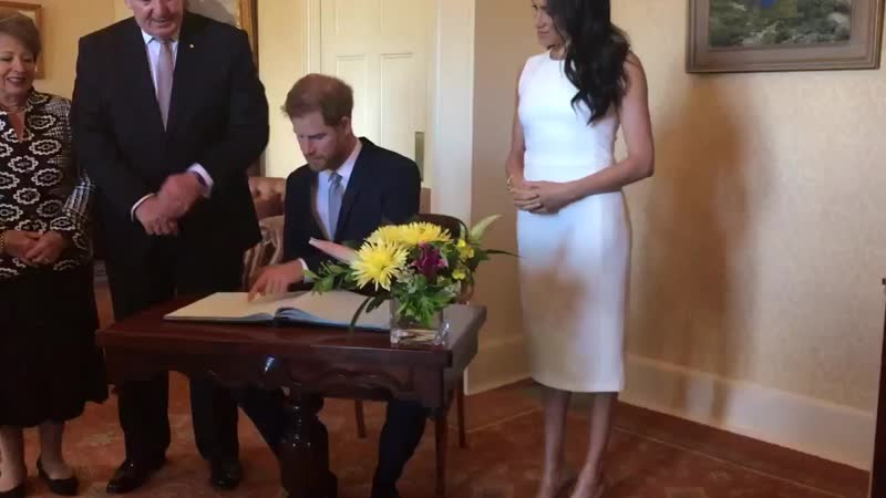 And they signed the official visitor's book....Royal Visit Australia