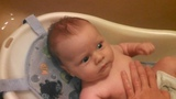 Infant Gets Nervous in Baby Bath (His Eyes Tell All)