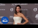 Jenna Dewan wears a white jumpsuit to the Baby2Baby gala