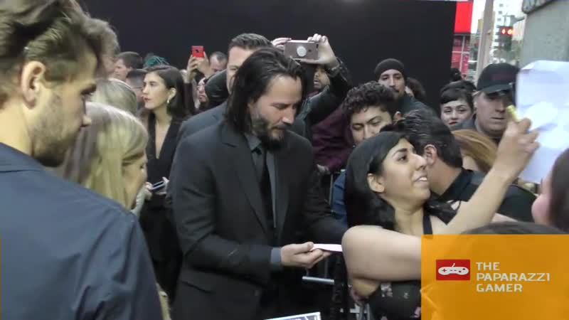 Keanu Reeves greets fans outside the John Wick Chapter 3 Parabellum premiere at