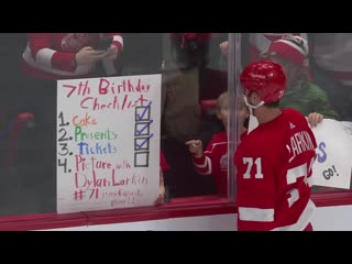 Dylan larkin gifts puck to young girl celebrating her seventh birthday