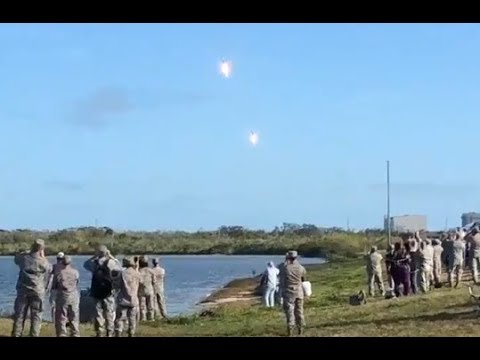 Crazy crowd reactions to twin Falcon Heavy booster landing.